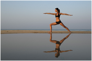 Carolyne Ji practising yoga on beach