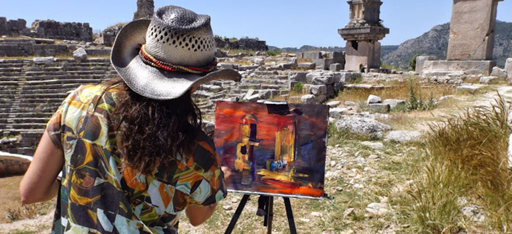 Anna Martin painting Ruins in Kalkan Turkey